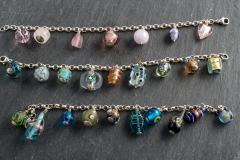 Silber, diverse Steine, Glas